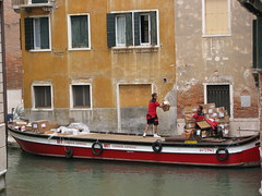 Delivering packages on canal in Venice, Italy (Dan_DC) Tags: venice red people italy men corporate boat italia workmen candid stock culture cargo business company maritime license delivery editorial boxes shipping job venezia atwork barge freight branding cultural brands rf brt packages fon onthejob imagebank occupations royaltyfree reduniforms corriereespresso flatfee otj culturalsignificance laboremployment