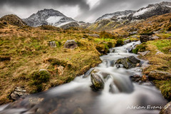 Winter Landscape (Adrian Evans Photography) Tags: rock snowdonia winter idwal water tryfanmountain riverside snow ogwenvalley wales creek waterfall carneddaumountains northwales tryfan sky glyderaumountains tryfanface cwmidwal landscape face ogwen mountains outdoor llynidwal clouds longexposure rapids river adrianevans stone valley landmark uk snowcapped