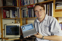 Happy 25th birthday, Linux (indianking1) Tags: happybirthday linux linuxbirthday linuxupdateshappybirthdaylinuxbirthday updates lookingatcamera men holding oneperson halflength portrait homeoffice prominentpersons bookshelf laptop linustorvalds laptopuser unspecified