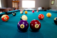 47 (KevinIrvineChi) Tags: pool macro macromonday sony indoors inside billiards bals balls bols felt green red purple orange 4 7 47 table game 10 9 5 8 depth field bokeh light lit shadows reflection happy birthday age number numbers dscrx100