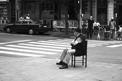 The Chairman Of The Street (Ren-s) Tags: street streetphotography passagepourpietons walkway chair guy man homme assis sitting chaise bruxelles belgium europe belgique ville city town towncenter centreville trottoire pavement sidewalk day daylight jour journe chapeau hat blackandwhite noiretblanc