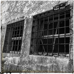Peniche Fortress - Old prison windows (Pedro Nogueira Photography) Tags: pedronogueira pedronogueiraphotography photography iphoneography iphone5 portugal peniche fort fortress fortification prison jail old stronghold windows bars rusty rust concrete iron metal blackandwhite monochrome building architecture outdoor abstract lines window texture