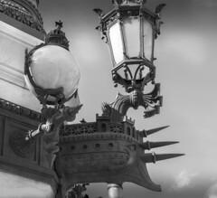Vintage lamp, Palais Garnier, Paris (Sorin Popovich) Tags: lamp lamppost streetlamp palaisgarnier vintage castiron bw blackandwhite paris france outdoors