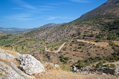 Peloponnesian Landscape at Mycenae, Greece (Herculeus.) Tags: 2016 archeologicalsite aug clouds farmsvineyardsfisheriesorchards greece highwaysroadways mountains mycenae peloponnese olivetrees outdoor outside landscape landscapes bouldersstonerocks mountainside hill mountain gulch ridge foothill canyon ngr