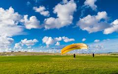 Trying to fly... (Nuno.Correia) Tags: landscape bluesky grass fields paragliding outdoor parquedasnaes whiteclouds paisagem cuazul nuvensbrancas relva parapente lisboa lisbon portugal nikond5300 nikon18140mm
