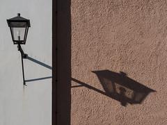 Lamp and shade (schauplatz) Tags: bayerischerwald bayerwald deutschland lamerwinkel urlaub cham lamp shadow contrast wall mauer