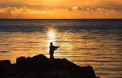 Hovs hallar, June 30, 2016 (Ulf Bodin) Tags: rock hav sunset sweden bjre beach sverige strand sea summer canoneos5dmarkiii hovshallar kust fishing canonef100400mmf4556lisiiusm klippor outdoor fiske solnedgng seascape night coast cliff fisherman bjre solnedgng skneln se ocean shore water