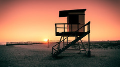 Dreaming Again (_flowtation) Tags: california county ca sunset sea vacation sky orange sun sunlight beach nature water birds strand fence landscape losangeles sand nikon rocks meer wasser waves glare sonnenuntergang sundown pacific stones teal huntington urlaub natur himmel sigma lifeguard surfing orangecounty zaun landschaft sonne baywatch kalifornien hollister felsen usopen pacificcoasthighway pazifik highwayno1 d7000