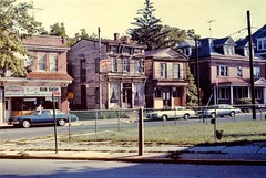 Crosswicks St Bordentown Old Buildings 1979 (jannetie) Tags: railroad trees houses windows cats house beach water architecture sailboat creek train docks cat river boats pier canal newjersey doors furniture colonial victorian nj sandbar trains canoe shore canoes storefront curtains sailor sailboats siding renovation clapboard mercercounty canoeclub delawareriver yachtclub shipbuilding boater boatclub delawareraritancanal canoer vintagephotographs sheers vintagephotograph crosswickscreek bordentown burlingtoncounty trentonnj duckisland bordentownnj yapewi yapewiaquaticclub sweetheartcurtains tiebackcurtains crisscrosscurtains