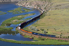 Blue and orange (Moffat Road) Tags: montanaraillink mrl bnsf manifestfreight freighttrain river water curves emd sd70ace 4400 lombardcanyon missouririver lombard montana mrlsecondsubdivision mrl2ndsub train railroad locomotive mt cliffs blue orange