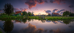 Panorama photo of the Zaanse Schans (jazzmatezz) Tags: thenetherlands holland zaanseschans panorama zaandijk dutch windmills reflection nisifilters zaansehuisjes clouds cloudscape sunset zonsondergang dsc1922 ngc nationalgeographic