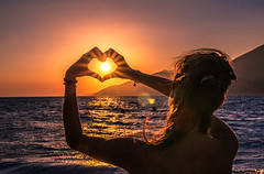 Sunset love (Vagelis Pikoulas) Tags: sun sunset sunburst sunshine sea seascape girl woman canon 6d august summer 2016 tokina 2470mm view landscape greece europe