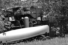Back of Woodshed (Jade Chanoquaway) Tags: blackandwhite bw contrast nikon nikkor d5500 decay debris outside outdoors canoe pots trees