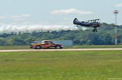Catching Up Fast (Fly Sandman) Tags: kylefranklin franklinsflyingcircus dracula demon1 biplane nealdarnell flashfire jettruck race darnellracing soundofspeedairshow stjoseph airshow airplane aircraft aerobatics vehicle pickup