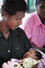 Father with newborn 6222 (shahidul001) Tags: people man male child baby infant girl family father daughter sleep sleeping srilankan srilankans vertical closeup color colour srilanka southasia asia drik drikimages