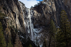 Bridalveil Fall in Winter (San Francisco Gal) Tags: bridalveilfall yosemitevalley yosemitenationalpark waterfall snow ice cliff granite tree