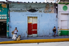 Orizaba, 2016 (Exit Imago) Tags: mexico orizaba blue colorful colourful paintedwall shop standing street streetphotography twopeople woman ~colour