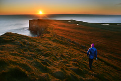 Towards the Midnight sun (Nils van Rooijen) Tags: midnight sun sunset iceland latrabjark west fjords sea ocean pole arctic horizon landscape hike nature travel grassland girl
