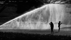 starshower (Keith Midson) Tags: utas universityoftasmania sprinkler girls girl water