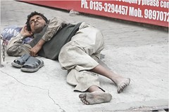 """Foxes have dens and birds have nests, but the Son of Man has no place to lay his head."" (Pejasar) Tags: candid street sleep cementbed resting olddelhi india caste dirtyfeet barefeet homeless dalit chain cracks drain"