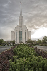 "Week 35 of 52 Theme: ""Hyperfocal Distance"" - Pines and Spire (sumoetx) Tags: week35of52 hyperfocal nikon d750 sunset lds mormon churchofjesuschristoflatterdaysaints temple holy sacred angel moroni utah sumoetx howardjackman cloudy storm wideangle oquirrhmountaintemple oquiirh mountain daybreak salt lake city slc saltlakecity building religion religious"
