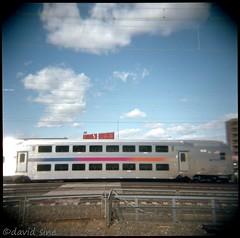 (david sine) Tags: linden nj newjersey train station tracks fence commute publictransport sky clouds wires stuff things holga holga120n plastic toy camera mediumformat 120 color kodak portra film scannednegative