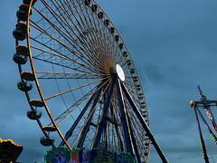 Beneath the Ferris wheel (Notquiteahuman1) Tags: ferriswheel bigwheel observationwheel giantwheel rodagigante volksfest badcannstatt cannstatt stuttgart swabia southgermany germany lights evening attraction amusementpark ride