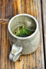 Mint Tea (polargrape) Tags: wood hot green cup water leaves ceramic table relax asian 50mm leaf nikon asia natural tea drink beverage relaxing drinking mint floating bubbles bubble mug nikkor float leigh refreshing herb boiling macarthur d800 boil   refresh  gangwondo gangwon  2013   polargrape