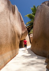Seychelles (hwinther) Tags: travel blue sky man tree beach nature beauty rock island sand paradise escape view bright rear sunny palm clear exotic granite tropical destination tropic leisure isolation seychelles exploration picturesque tranquil ladigue
