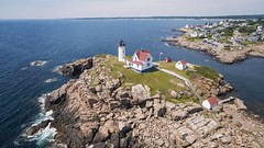 Nubble (Aaron Mello Photography) Tags: ocean new york travel summer england sky lighthouse tourism clouds island photography town rocks maine atlantic phantom nubble dji