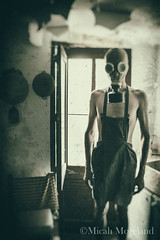 Housecall (micahmoreland) Tags: creepy horror surreal surrealism surrealist conceptual costume wheezer world war 2 ii dystopian scary haunting wet plate grunge texture male toxic death danger gas mask thin skinny abandoned house urbex urban exploration kitchen disturbing comical
