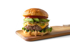 california burger avocado slices sprouts chipotle aioli tomato lettuce grilled onion jalapenos toasted brioche bun cutting board (PersonalCreations.com) Tags: california food dinner tomato recipe lunch avocado burger lettuce treat onion grilled sprouts bun chipotle brioche slices toasted jalapenos aioli