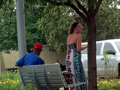 IMG_6998 (kennethkonica) Tags: canonpowershot canon global random hoosiers outdoor talking candid street streetphotography marioncounty midwest america usa indiana indianapolis indy hat trans busstop people sit sitting seat seated bench reading dress glasses summer july shoulders