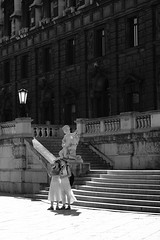 Selfie with angels (PIXXELGAMES - Robert Krenker) Tags: vienna wien fujifilm fujinon twogirls blackandwhite blacknwhite bnw monochrom biancoenero snapshot tourists architecture portrait hat white black younggirls young longdress heels sandals candid fujicams