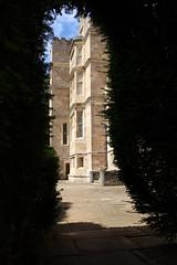 Fountains Hall through the hedge (ir0ny) Tags: fountainsabbey nationaltrust studleyroyalwatergardens studley watergardens fountainshall hall yorkshire