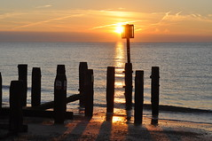Morning sun appeaaring above cloud bank (Kirkleyjohn) Tags: sun sunrise sunshine morning silhouette silhouettes groyne beach light glitterpath sky sea seaside seashore seascape