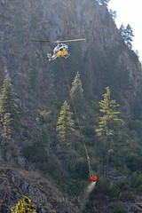 BAMBI BUCKET (Kaiserjp) Tags: n338wn uh1 huey bambibucket tanker8 leavenworth washington wa forestfire waterdrop firefighting helicopter