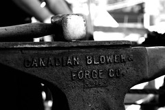 Anvil & Hammer (Jade Chanoquaway) Tags: nikon nikkor d5500 cans2s fall autumn october ontario canada blackandwhite black white grey gray grayscale greyscale bw contrast light shadow monochrome silhouette shadows metal iron wood bone steel anvil hammer text words blacksmith farrier dof tool tools outside outdoors sun sunlight sunshine people