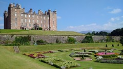 Drumlanrig Castle (gowersaint) Tags: britain uk scotland dumfries galloway drumlanrig parterre gardens flowerbeds beds gardening design creation recess bank towers castle cupola bonnieprincecharlie history historic medieval stuart georgian aristocracy nobility gentry duke dukedom flowers stairs topiery trees hedges layout summer skies blue