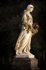 (Joseph Austin) Tags: sunset art graveyard statue stone female garden death artwork madonna lookingdown motionless frozenintime workofart colorimage stjoachim verticalimage femaleface madonnastatue humanlikeness stjoachimcemetery