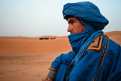 Our Berber guide (Sebastian Anthony) Tags: blue sahara yellow sand desert morocco berber camels