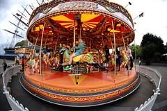 The Magic Roundabout (pooly7) Tags: fun funfair magic mange childhood fair outdoors roundabout fisheye tournicoti tournicoton greenwich london londres turn around about urban street