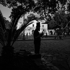 The Ghost Walk (S.A. Street Photographer) Tags: urban city man the alamo ghost street streetscene black blackandwhite monochrome scary walk sidewalk hat sanantonio people
