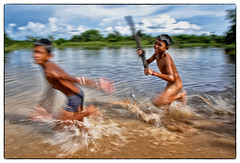 Kratie, Cambodia - Life can be cruel yet fun (Mio Cade) Tags: chasing run water river children boy kratie cambodia panning fun travel