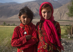 Portrait of afghan girls dressed in red clothes, Badakhshan province, Qazi deh, Afghanistan (Eric Lafforgue) Tags: 2people 89years afghan415 afghanistan badakhshanprovince blondehair centralasia children childrenonly colourimage community girlsonly horizontal indigenousculture ismaili lifestyles lookingatcamera outdoors photography portrait qazideh red traditionalclothing twopeople waistup wakhan wakhi
