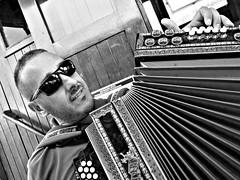 Sailor Croatia (saxild) Tags: olympus pen pl5 zuiko mzuiko 17mm 17mm18 digital bw black white sailor portrait accordion musician glasses sunglasses opatiya croatia