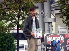 IMG_1951 (kennethkonica) Tags: canonpowershot canon global random hoosiers outdoor talking candid street streetphotography marioncounty midwest america usa indiana indianapolis indy panhandler beg begging sign people persons october teeshirt face facialhair hair beard fall signs
