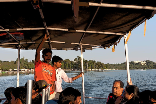 Cartoon - Staff and tourists in a tourist boat on the Fateh Sagar Lake in Udaipur
