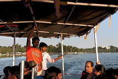 Cartoon - Staff and tourists in a tourist boat on the Fateh Sagar Lake in Udaipur (Ashish A) Tags: sky people plants india lake plant building green water buildings boat action cartoon bluesky greenery dslr visitors visitor canondslr digitalslr rajasthan udaipur metalstructure canonslr manmadelake canoncamera peoplesitting sittingpeople canoneos50d fatehsagarlake overheadcover shoreoflake touristsinboat