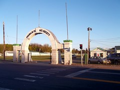 Main Gate Franklin County Fairgrounds. (dccradio) Tags: malone ny newyork northernnewyork upstatenewyork franklincountyfair fairgrounds malonefair sky bluesky fair carnivallot tree trees greenery crosswalk walksign dontwalksign gate maingate fairgate arch car truck pickuptruck redcrossstation firstaidbuilding